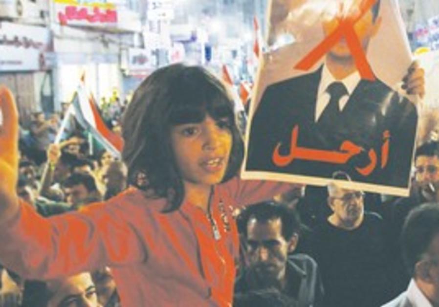 Girl holds poster of Assad