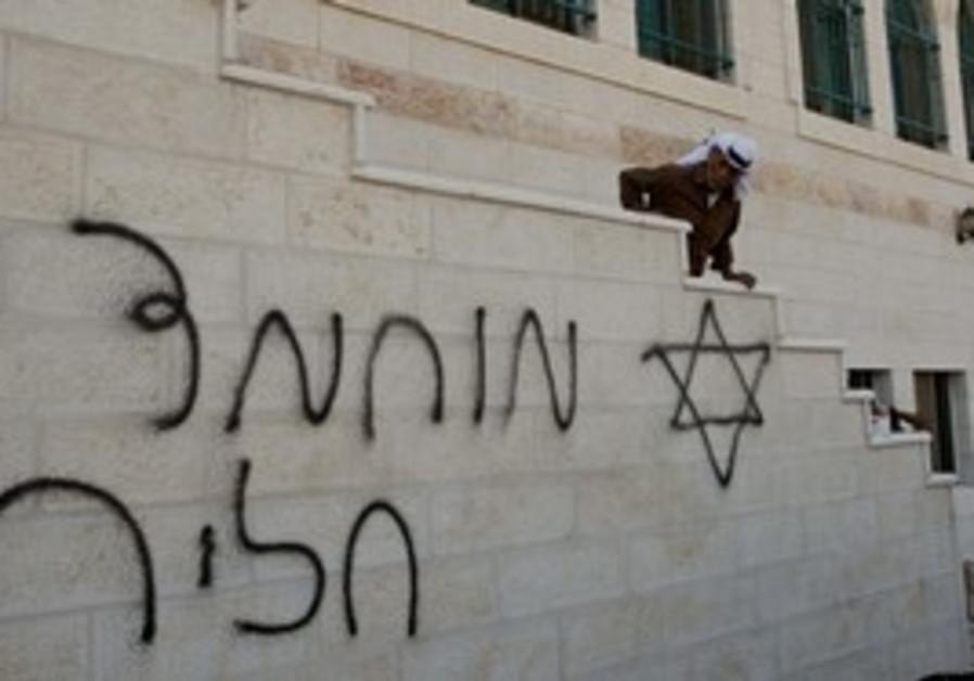 Graffiti on a mosque near Nablus, Monday