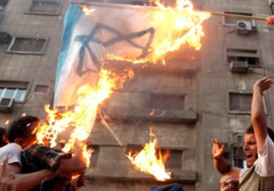 Cairo: Protesters burn an Israeli flag