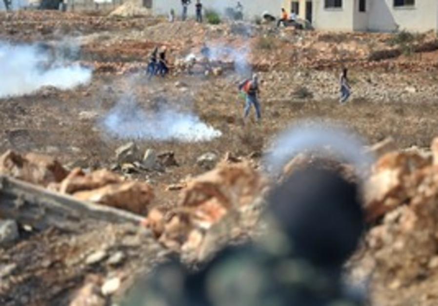 IDF tear gas fire at stone throwers in Nebi Salah