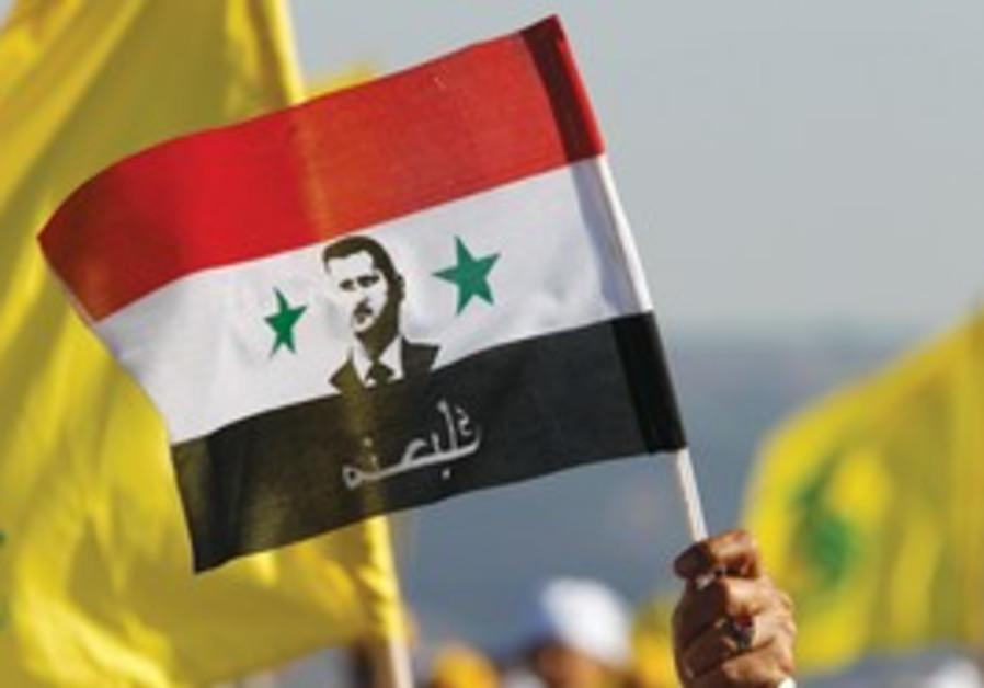 Syrian flag depicting President Bashar Ass