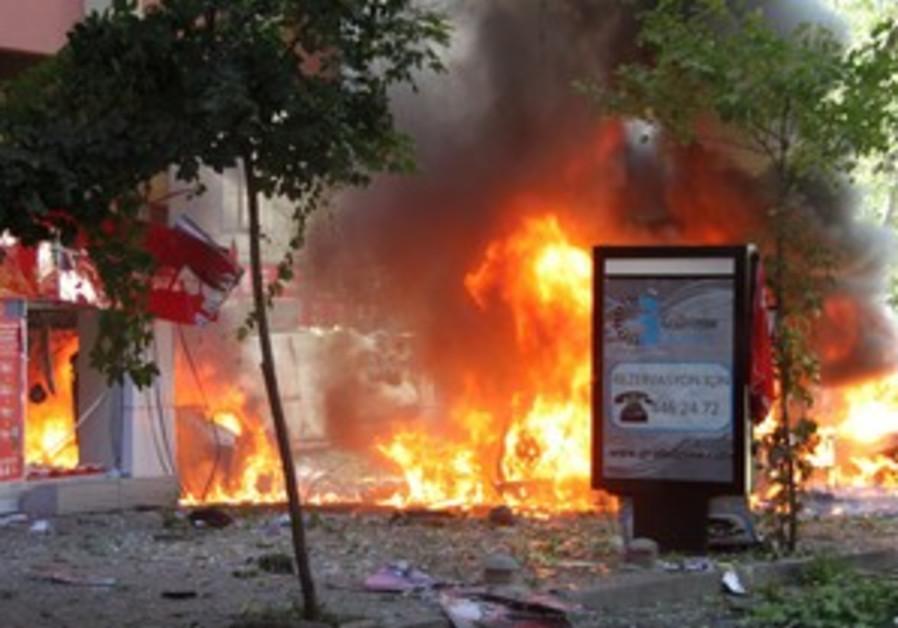 Flames seen in street after bomb blast in Ankara