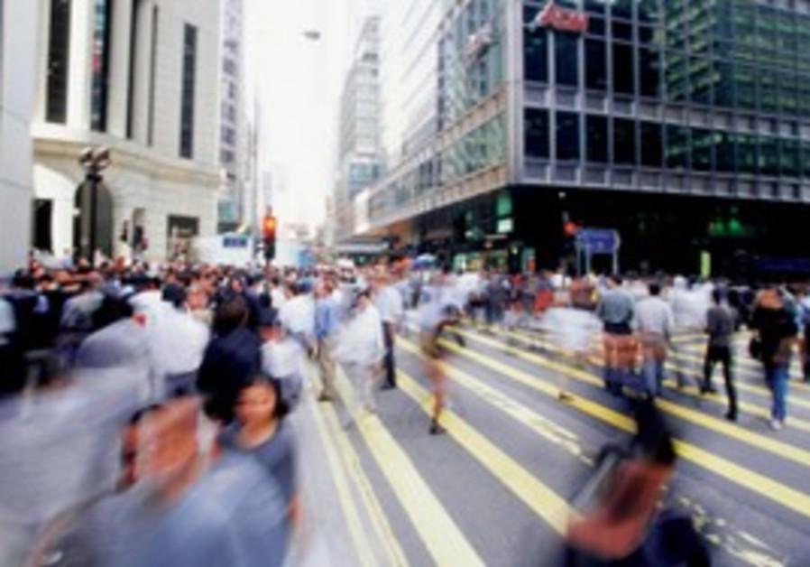 Pedestrians crossing a city street [illustrative]