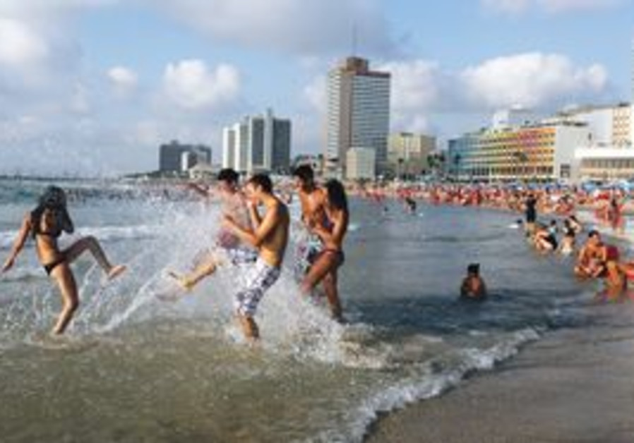 Playing in the water at a Tel Aviv beach