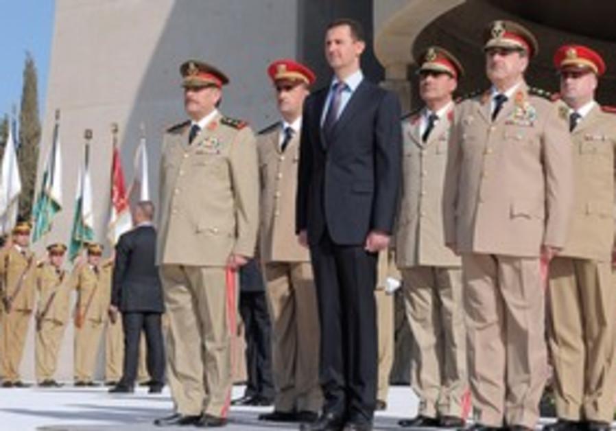 Syrian President Bashar Assad with army generals