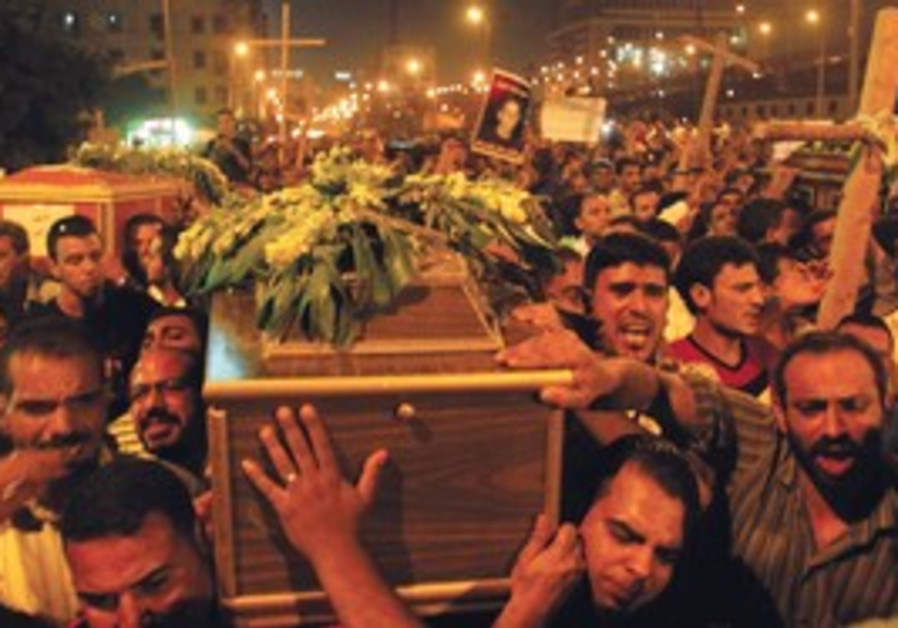 COPTS ATTEND a mass funeral in Cairo