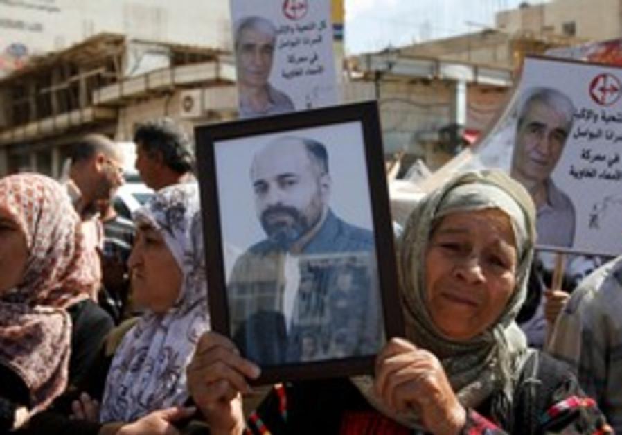 Palestinian woman at Ramallah prisoners rally