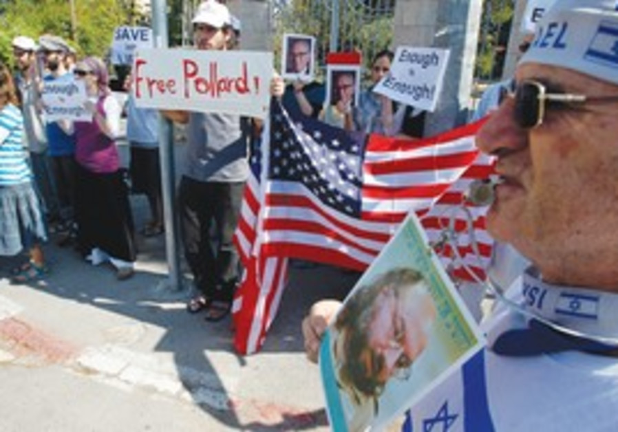 Pollard supporters stand outside US Justice Dept.