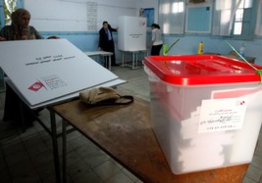 Government workers set up polling station in Tunis