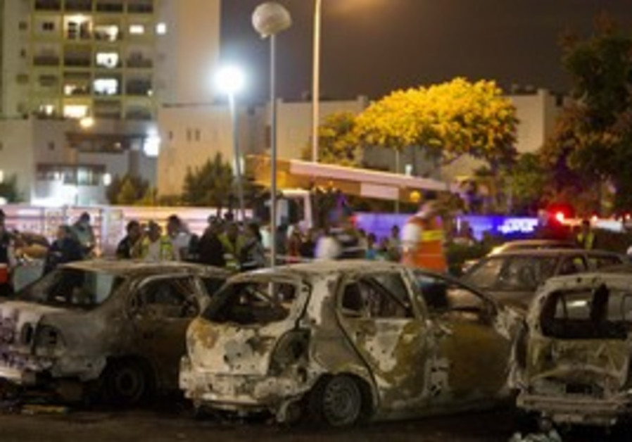 Cars damaged in Ashkelon from Gaza Rockets
