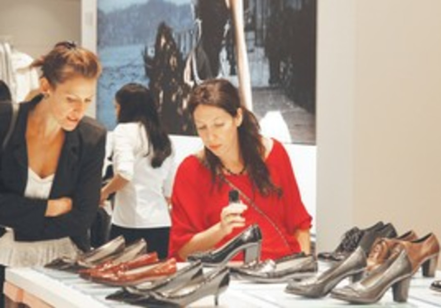 Shoppers browse in newly opened Hamashbir store