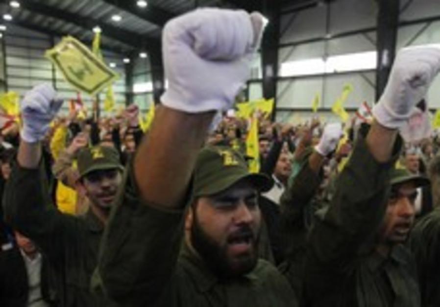 Lebanon's Hezbollah militants chant slogans
