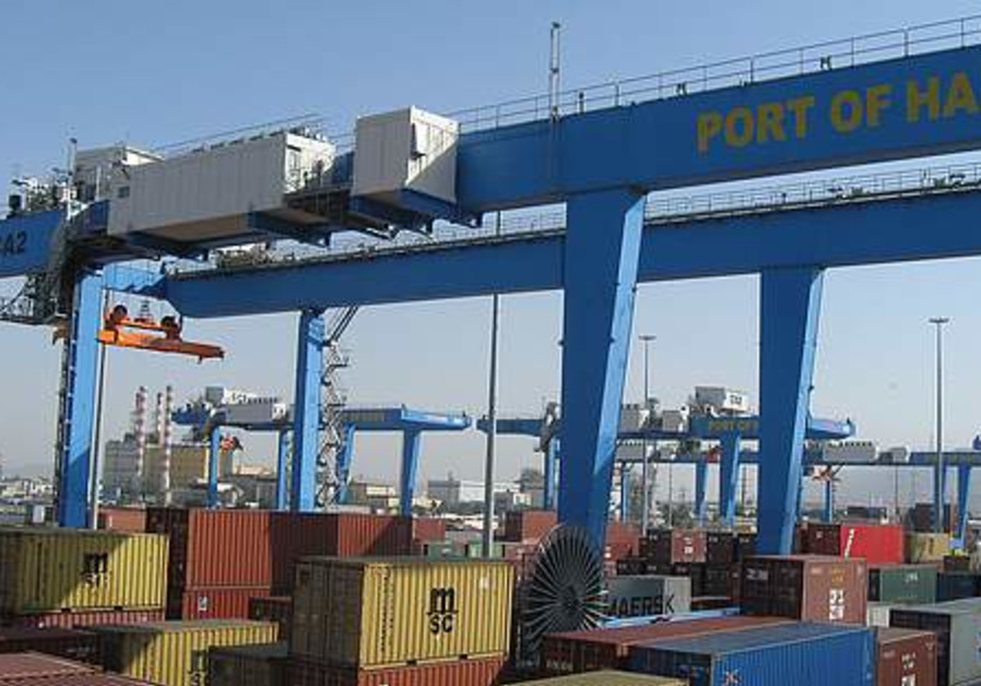 A SAFE HARBOR. Modern ship-to-shore cranes dominat