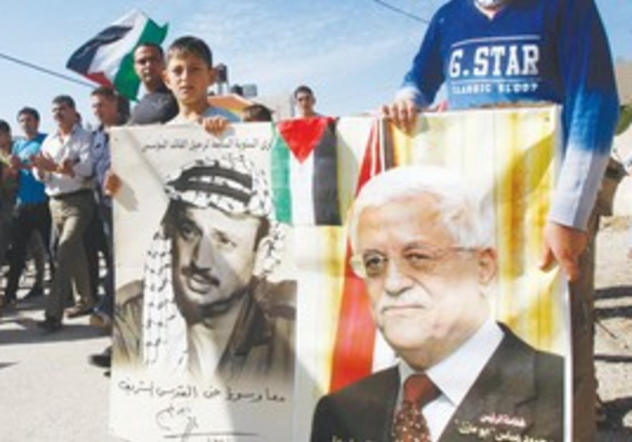 Children hold placards of Arafat and Abbas
