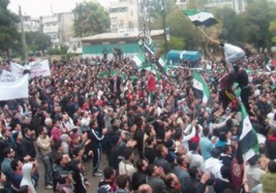 Syrian demonstrators protest against Assad in Homs