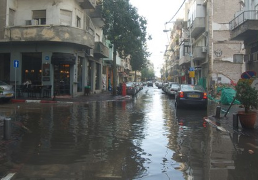 Rain floods streets in TA's Florentine area
