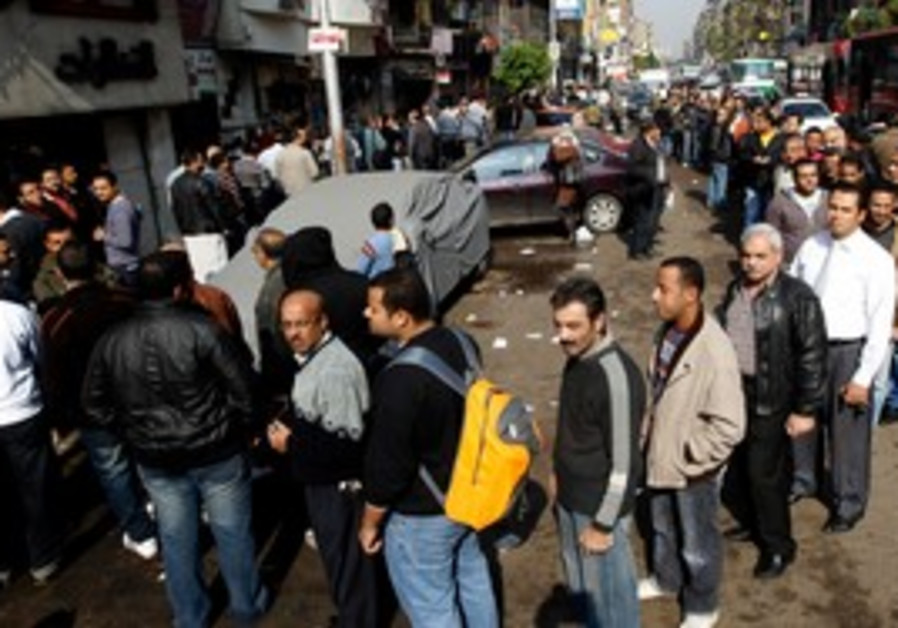 Egyptians wait in line to vote
