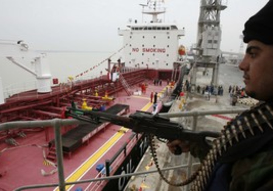 Policeman guards Iranian oil tanker