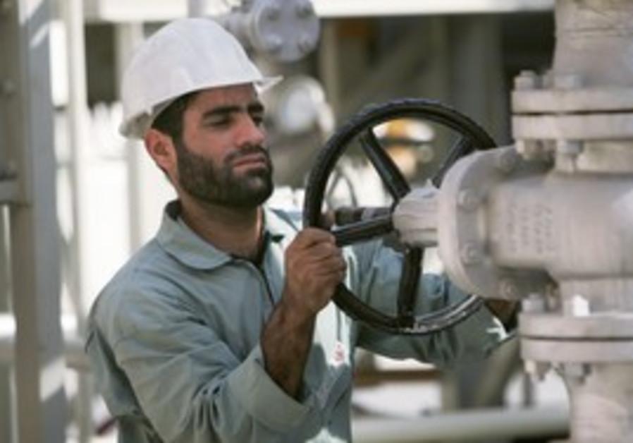 An Iranian oil worker