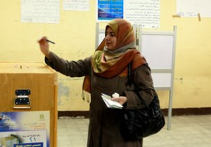 Woman casts ballot in egyptian elections