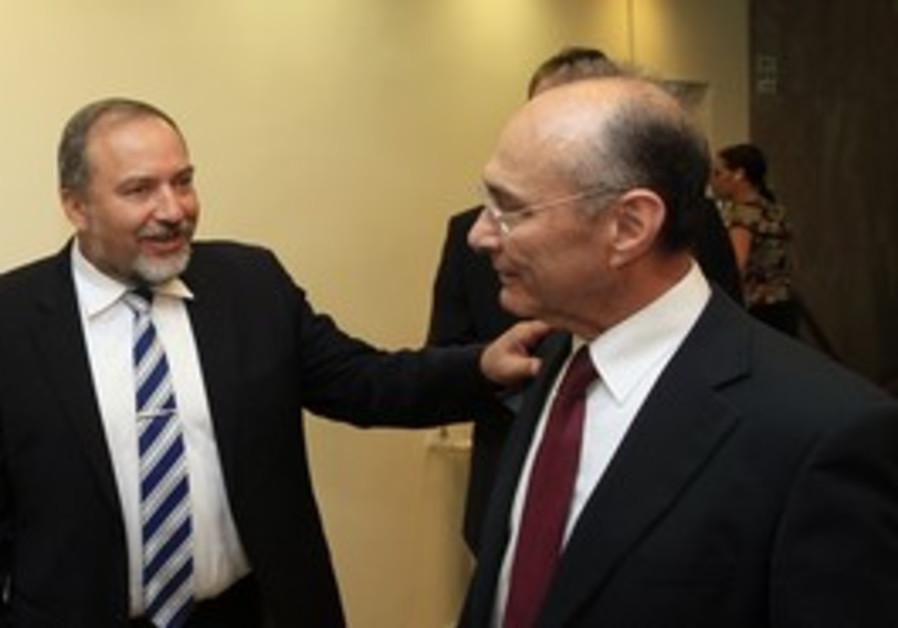 Uzi Landau (R) and Avigdor Lieberman (L)