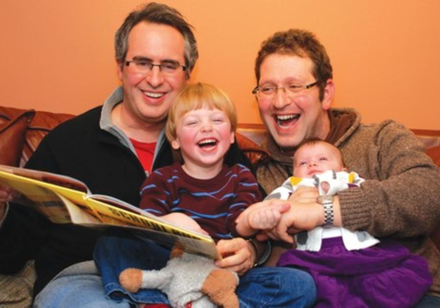 Yosef Weinstock and Aviad Stier with their kids
