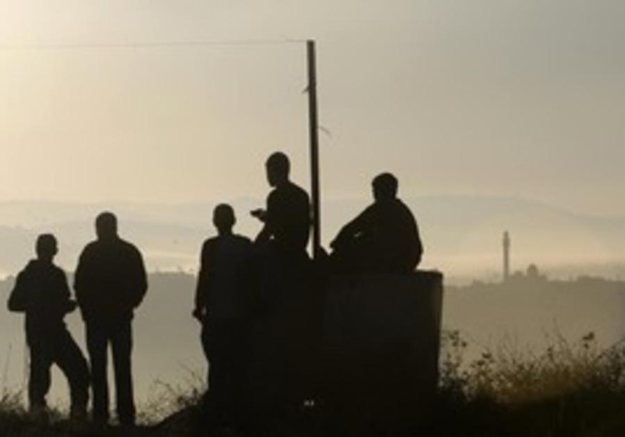 Settlers gather for prayer in Ramat Gilad