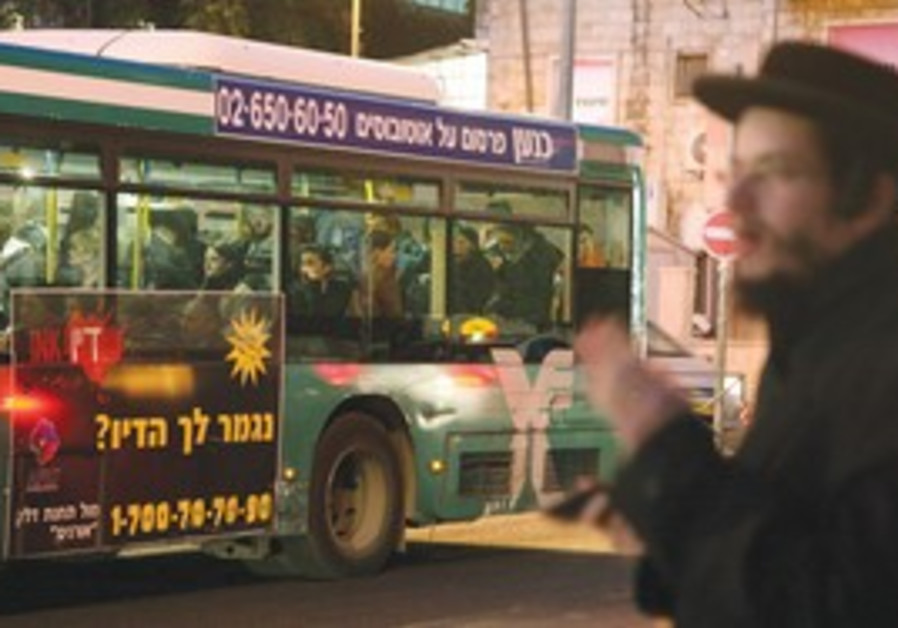 Haredi man near a bus