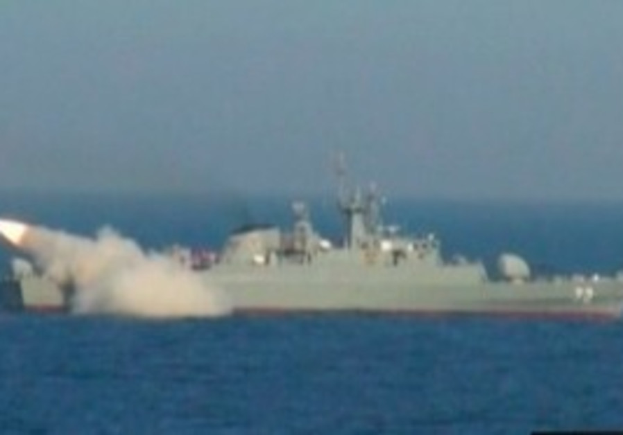 Iranian warship launches a missile
