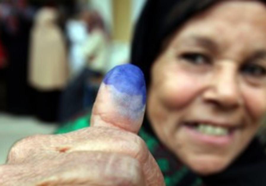 Egyptian woman shows stained finger after voting