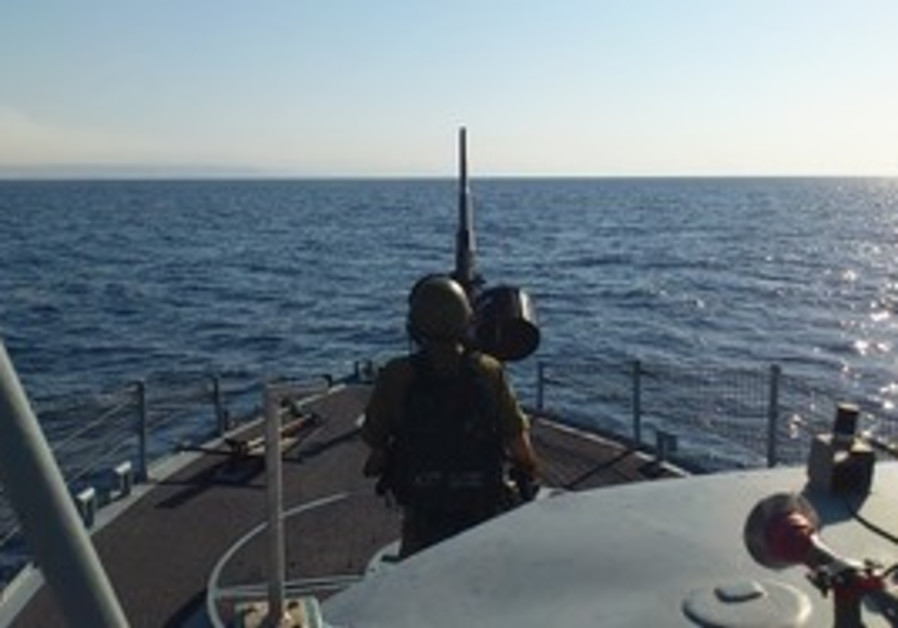 Sailor mans cannon during routine Red Sea patrol