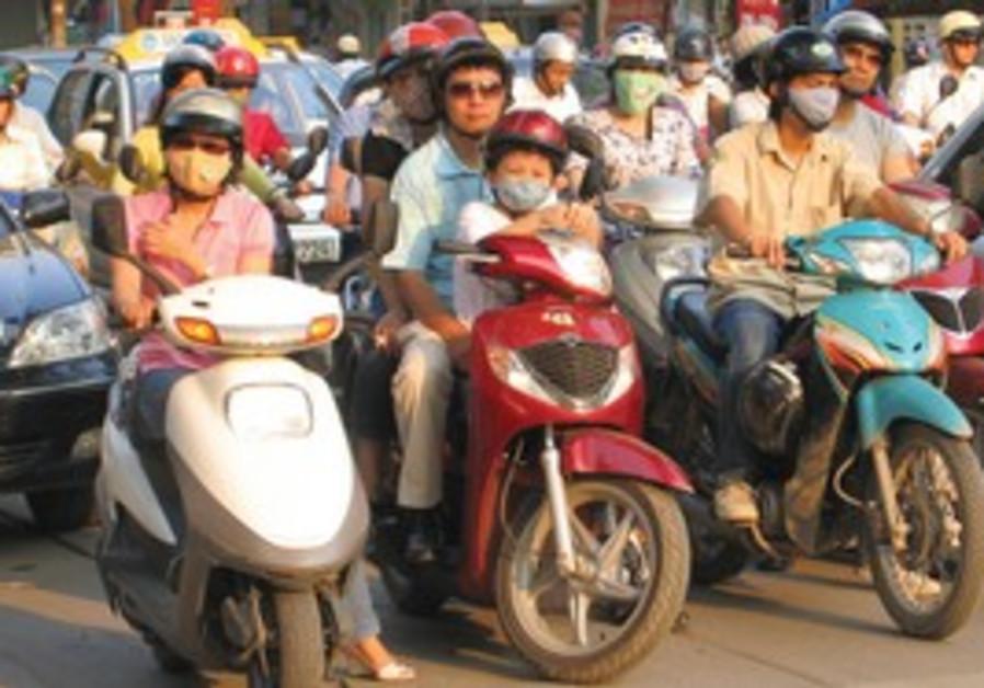Motorcyclists in Vietnam.