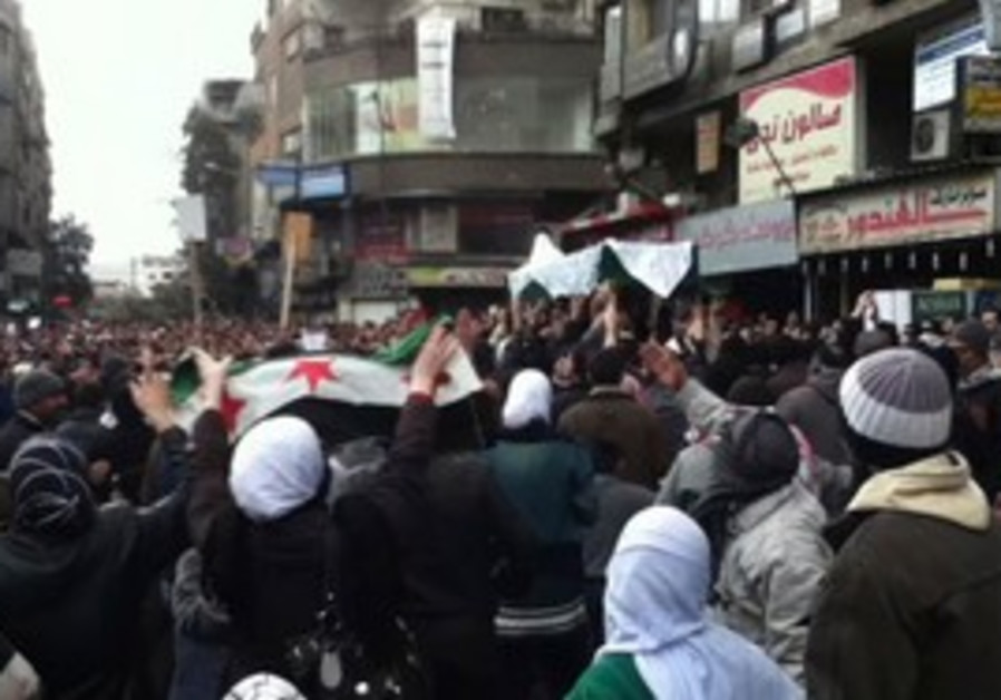 Anti-regime Syrian protesters carry coffin