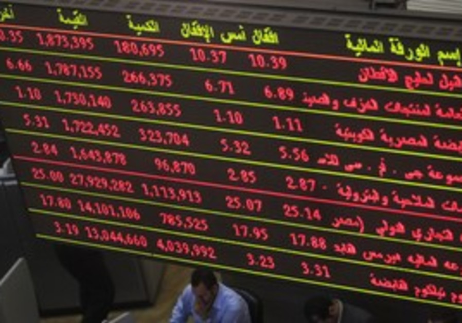 Traders work at the Egyptian Stock Exchange