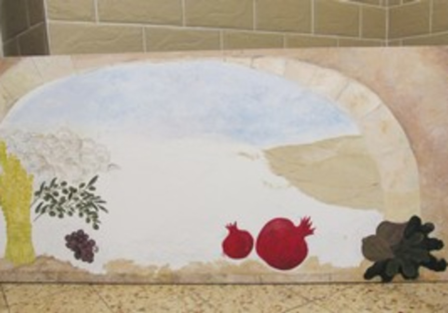 Nahalot mothers work on Seven Species mural
