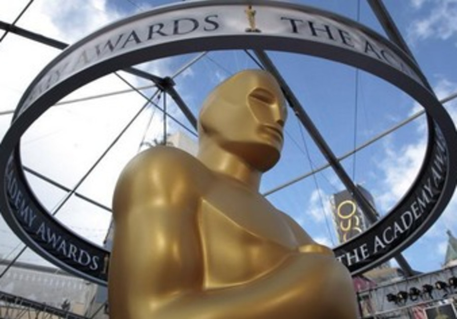 An Oscar statue is seen beneath plastic sheeting