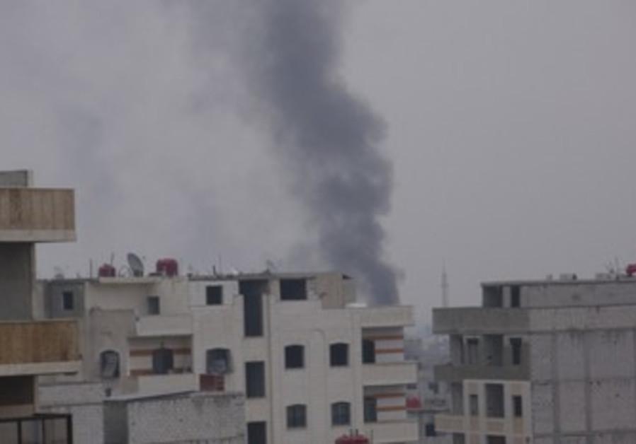 Smoke rising from Damascus suburb [illustrative]