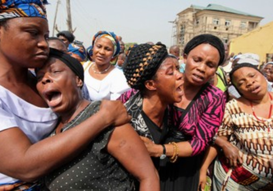 Nigerian women weep after Christmas Day bombing.