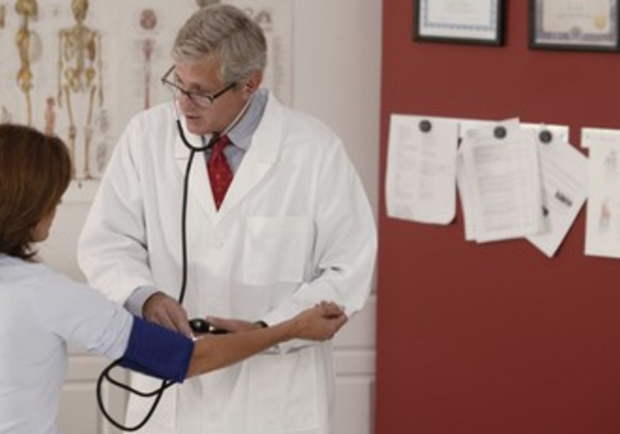 Doctor examines woman for heart problems