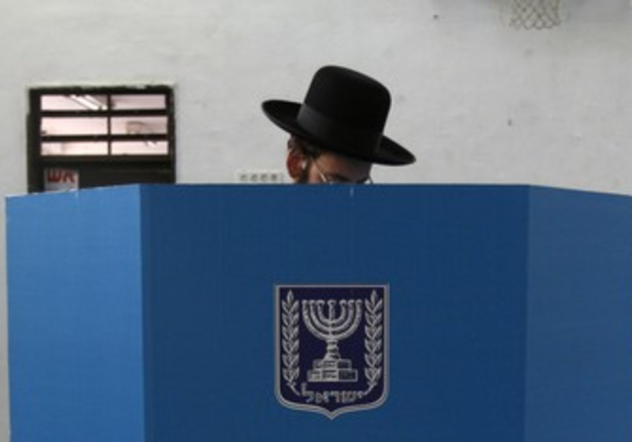 Haredi man casts ballot in elections [file]