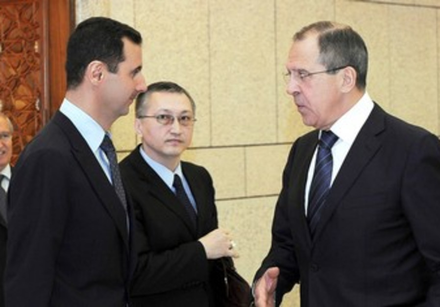 Syria's Assad meets Russian FM Lavrov in Damascus
