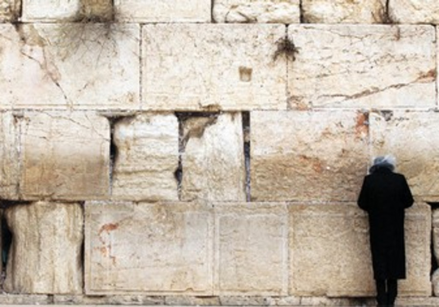 Man prays at Western Wall