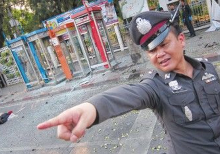 Thai policeman at the scene of Bangkok bombing
