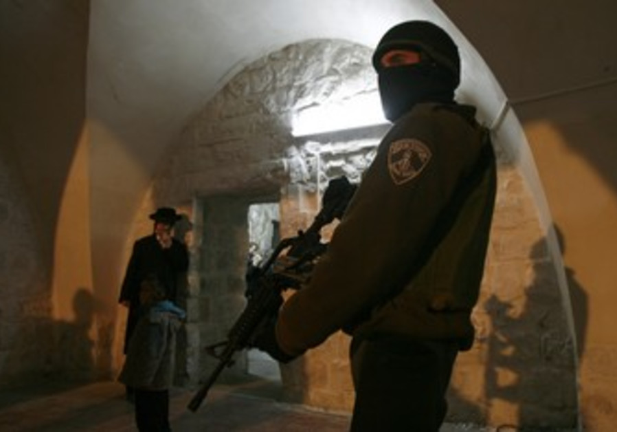 IDF soldier stands guard at Joseph's Tomb