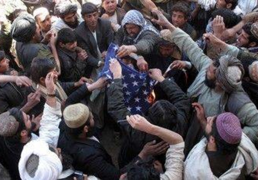 Afghan protesters burn a US in Helmand province