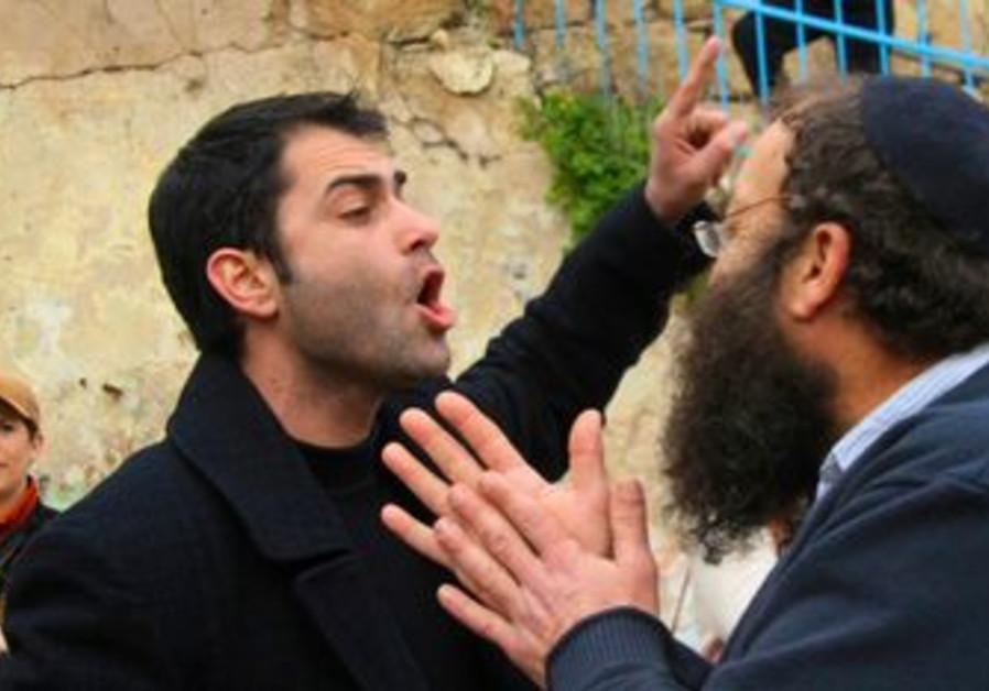 Meretz activist Gitzin argues with Baruch Marzel