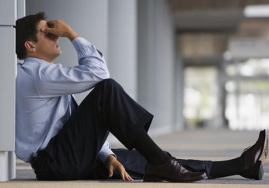 Overwhelmed anxious businessman