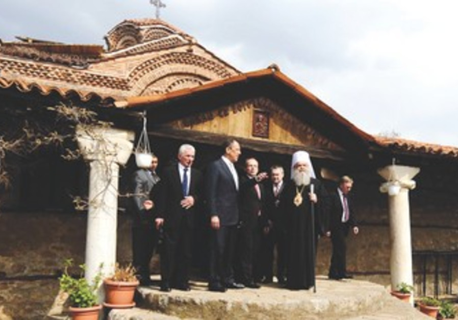 MACEDONIAN ARCHBISHOP in front of church
