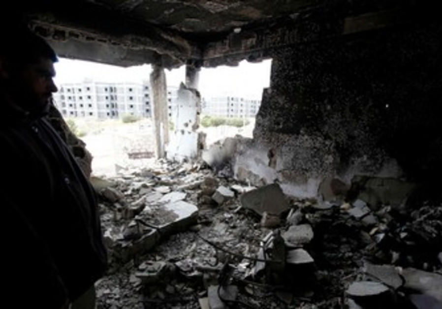 Syrian man surveys his damaged home [file]
