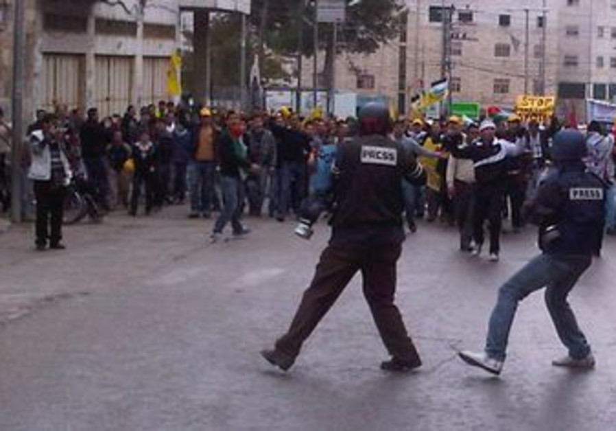 Journalists cover a protest in Hebron